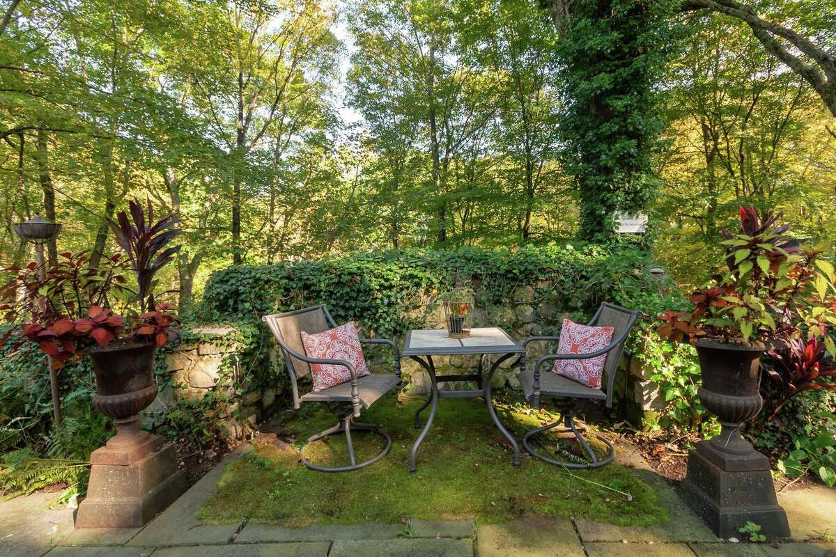 The attractive grounds features attractive landscaping and outdoor