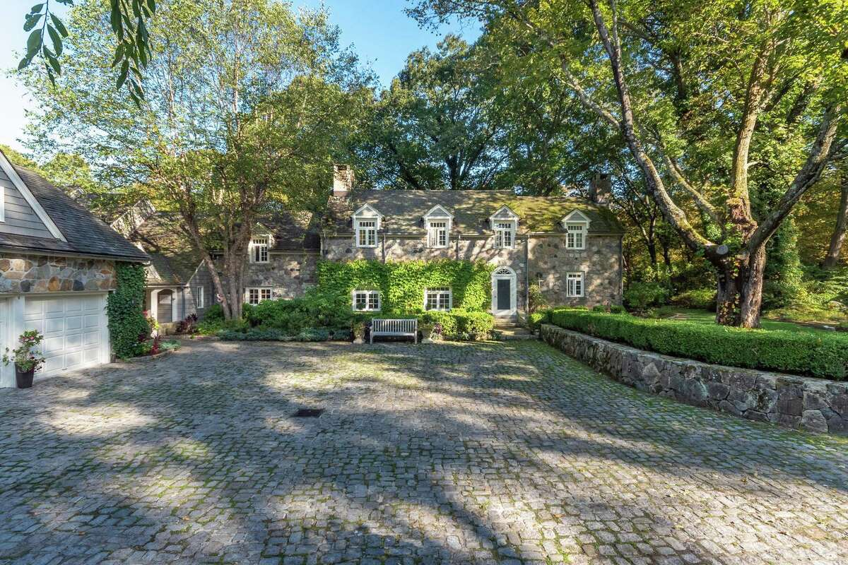 The European-style stone colonial house at 354 Nod Hill Road in Wilton was built by famed stone architect Frazier Peters and it is called Old Stone.