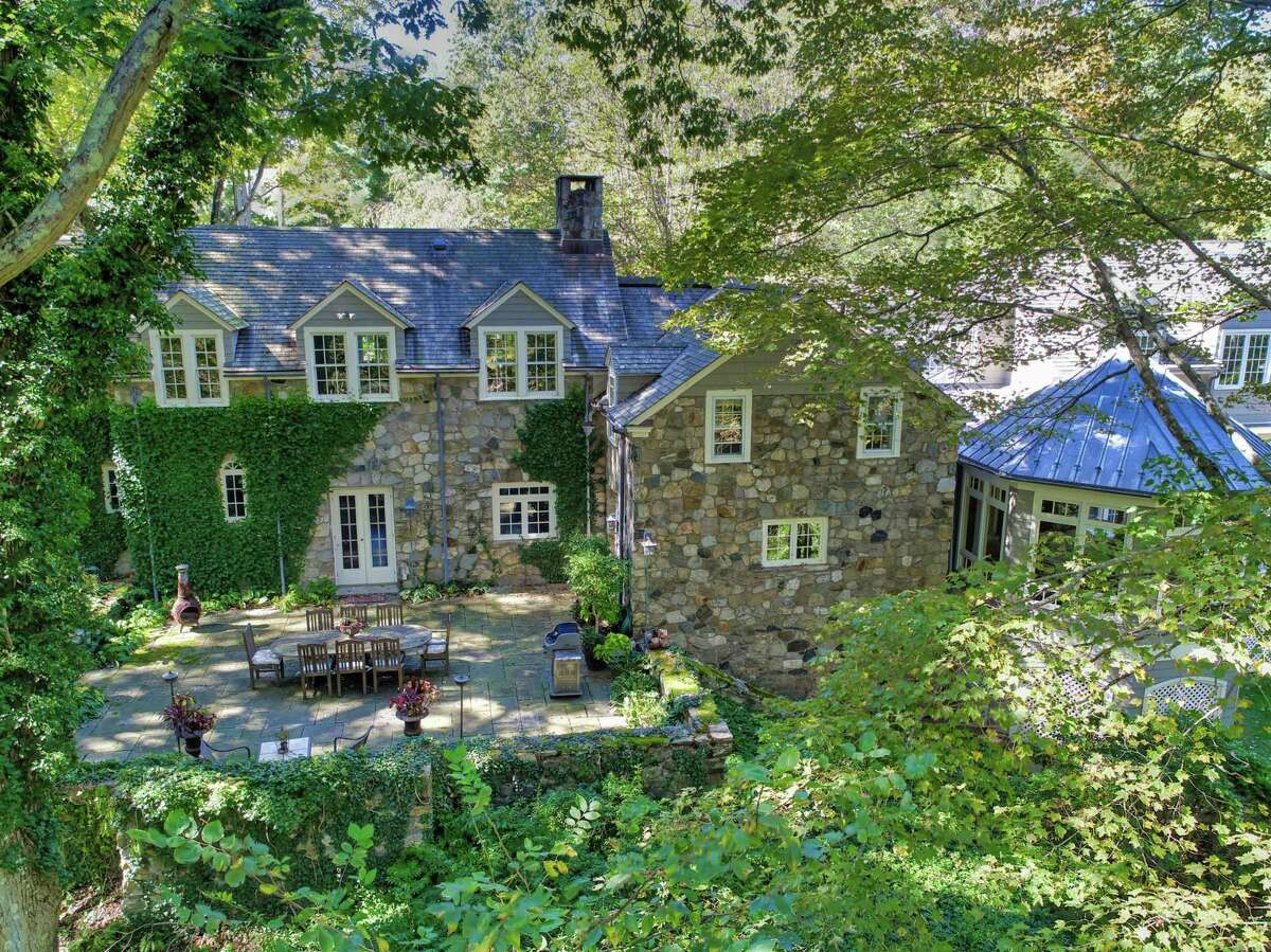 The European-style stone colonial house at 354 Nod Hill Road in Wilton was built by famed stone architect Frazier Peters and it is called Old Stone. Peters is not only known for his distinctive stone houses, but also for his thoughtful placement of those houses within a natural setting, often near a pond or stream.
