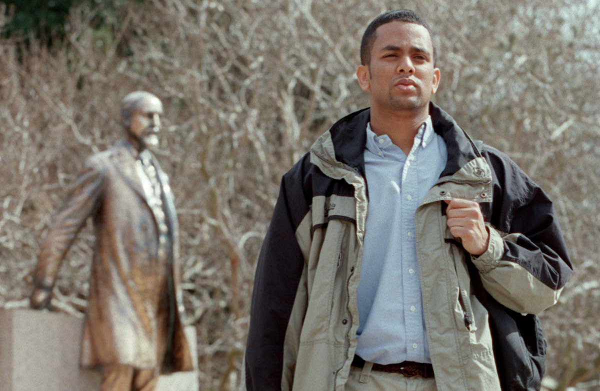 In this 2002 photograph, Bereket Bisrat, spokesman for A&M's African-American Student Coalition at the time, walks past the statue of former A&M President Sul Ross on the College Station campus.
