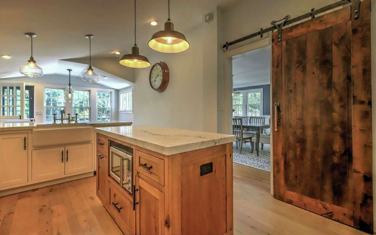 Separating the kitchen and dining room is a sliding barn door.