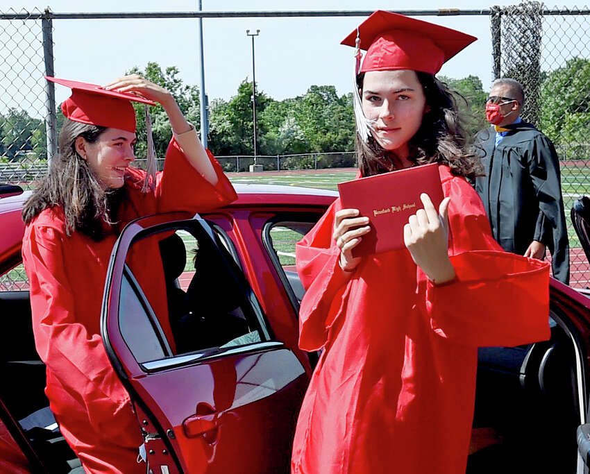 Branford, Connecticut - Monday, June 15, 2020: Adrienne and Julianne Dillon return to their cars after receiving their diplomas as Branford High School holds a