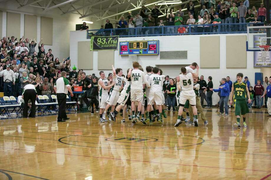 Pine river celebrates a district title at Evart during the 2012-13 season for boys basketball. (Pioneer file photo)