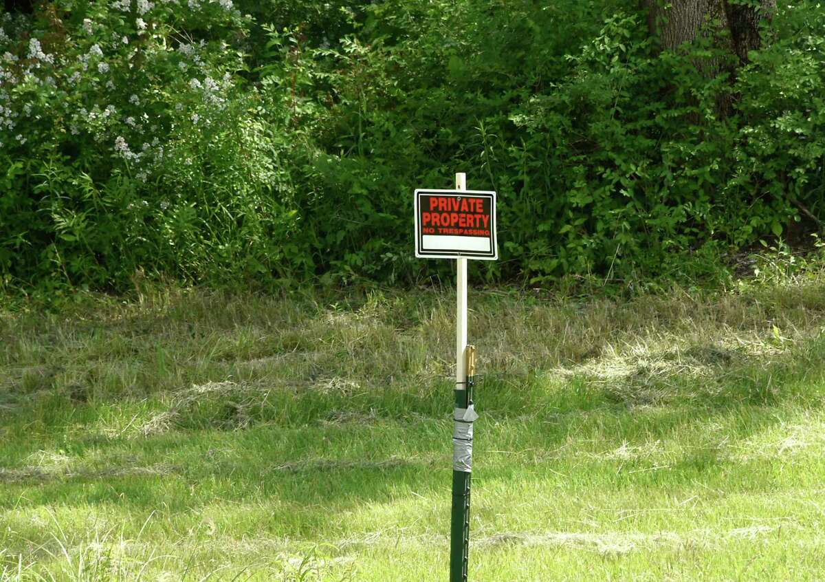 """A no trespassing sign is seen on part of the nearly 30 acre patch of ?""""forever wild?• forest in the back of Tony Gorman's home on Monday, June 15, 2020 in Loudonville, N.Y. The land has become the center of a court dispute between neighbors as well as the descendants of a wealthy family with local ties and one of the several Audubon Societies that exist. (Lori Van Buren/Times Union)"""