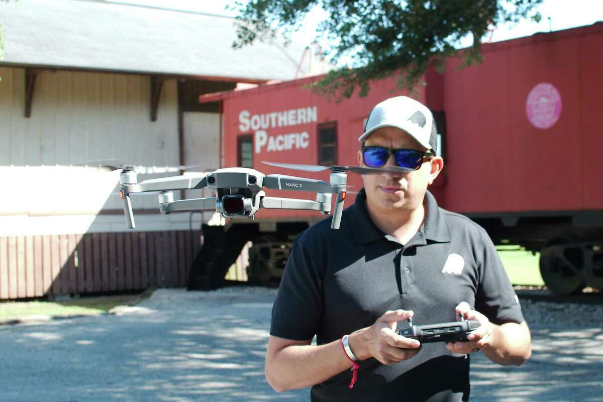 Casper Productions drone operator Jake Wynant takes aerial footage last year during the production of a video about the Pearland railroad depot. But ambitious plans to renovate the depot and develop it as an event venue and museum have since ground to a halt as the local economy was affected by the novel coronavirus pandemic.