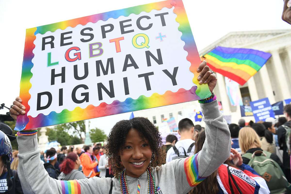 (FILES) In this file photo taken on October 08, 2019 Demonstrators in favour of LGBT rights rally outside the US Supreme Court in Washington, DC, as the Court holds oral arguments in three cases dealing with workplace discrimination based on sexual orientation. - The US Supreme Court ruled June 15, 2020 that federal protections against workplace discrimination apply equally to sexual orientation, contrary to the position taken by the administration of President Donald Trump. (Photo by SAUL LOEB / AFP) (Photo by SAUL LOEB/AFP via Getty Images)