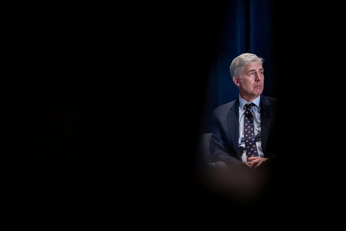 FILE -- Supreme Court Associate Justice Neil Gorsuch speaks at the Federalist Society's 2019 National Lawyers Convention in Washington, Nov. 16, 2019. Gorsuch led the way on one of the most sweeping gay rights rulings in the court's history, protecting gay and transgender people from workplace discrimination and confounding those who thought he would be a reliable bulwark against such positions. (Samuel Corum/The New York Times)