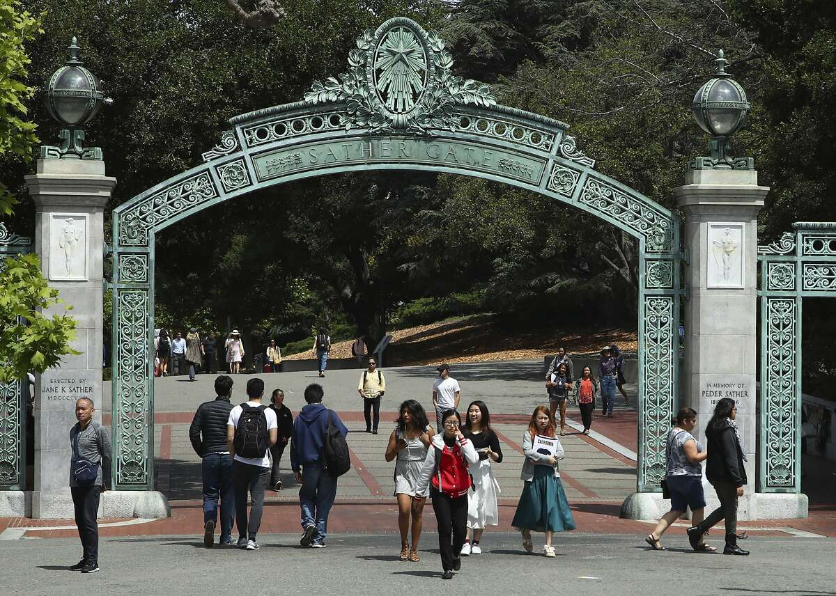 In this May 10, 2018, file photo, students walk past Sather Gate on the UC Berkeley campus.