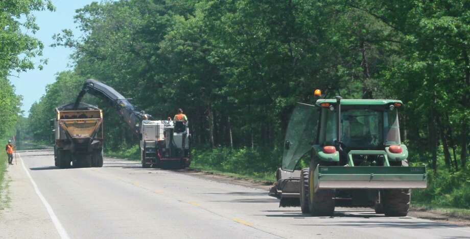 The resurfacing of 5.62 miles of Stronach Road from US-31 to M-55 in Filer Township and Stronach Township began Monday. The project is expected to be completed by Oct. 3. (Kyle Kotecki/News Advocate)