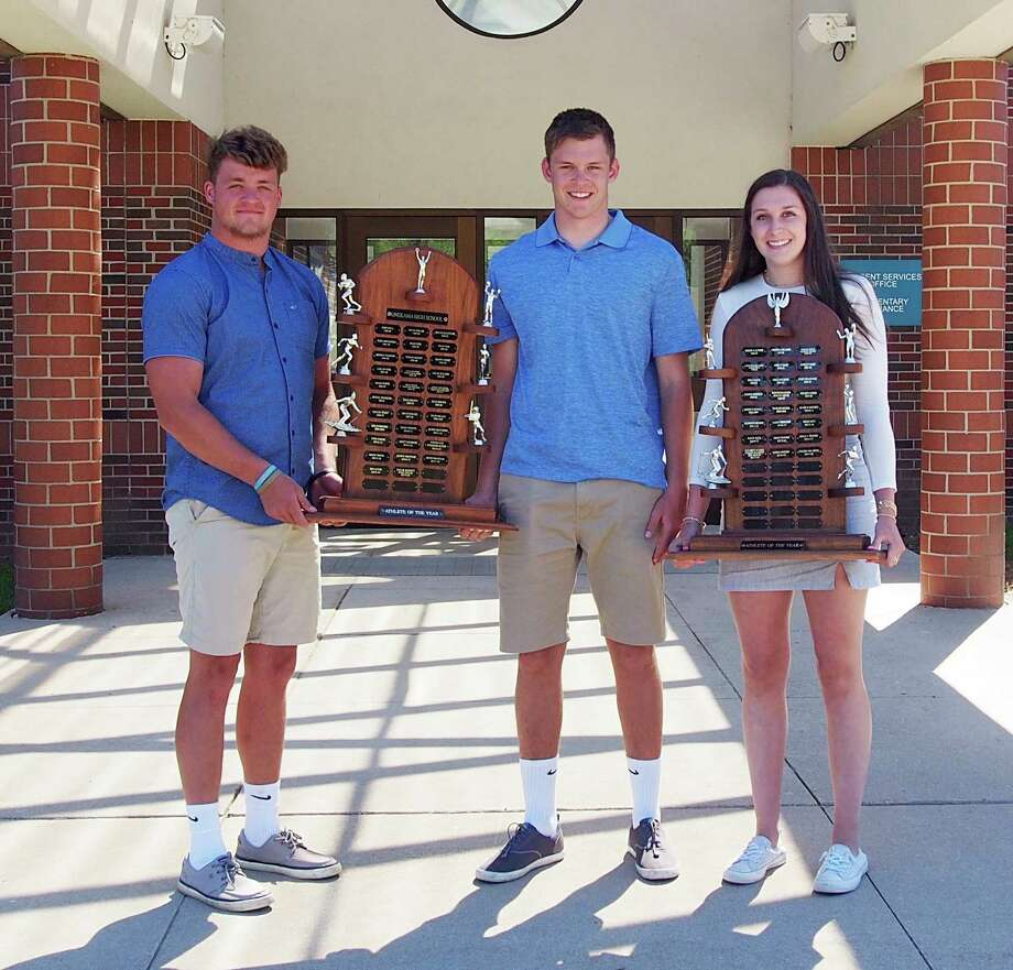 From left to right, Wade Sedlar, Taylor Bennett and Colleen McCarthy were named Onekama's Athletes of the Year. (Courtesy photo)