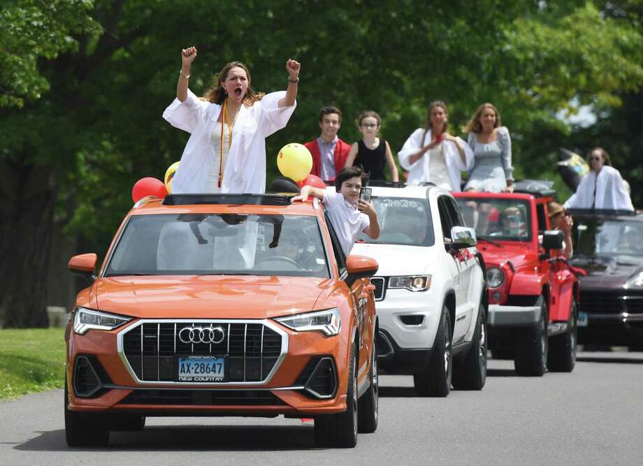 Christina Poterova and other new graduates celebrate during the New Canaan High School Class of 2020 drive-thru graduation parade at Waveny Park in New Canaan on Monday. The 301 graduates of New Canaan's Class of 2020 took a raucous ride through town with their families as teachers waited to congratulate them for their achievements as they passed through Waveny Park. Photo: Tyler Sizemore / Hearst Connecticut Media / Greenwich Time