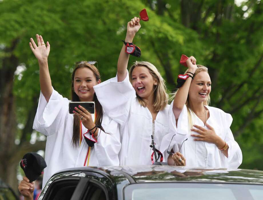 New graduates Sophie Smith, left, Elle Brockhaug, center, and Brooke Barber to teachers during the New Canaan High School Class of 2020 drive-thru graduation parade at Waveny Park in New Canaan, Connecticut, recently. The 301 graduates of New Canaan's Class of 2020 took a raucous ride through town with their families as teachers waited to congratulate them for their achievements as they passed through Waveny Park. This letter writer gives his opinion about an article at the top of the front of the New Canaan Advertiser's Thursday, June 18, 2020, print edition. Photo: Tyler Sizemore / Hearst Connecticut Media / Greenwich Time