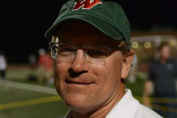 The Woodlands girls cross country and track coach Noel Hansen has retired from his position after …
