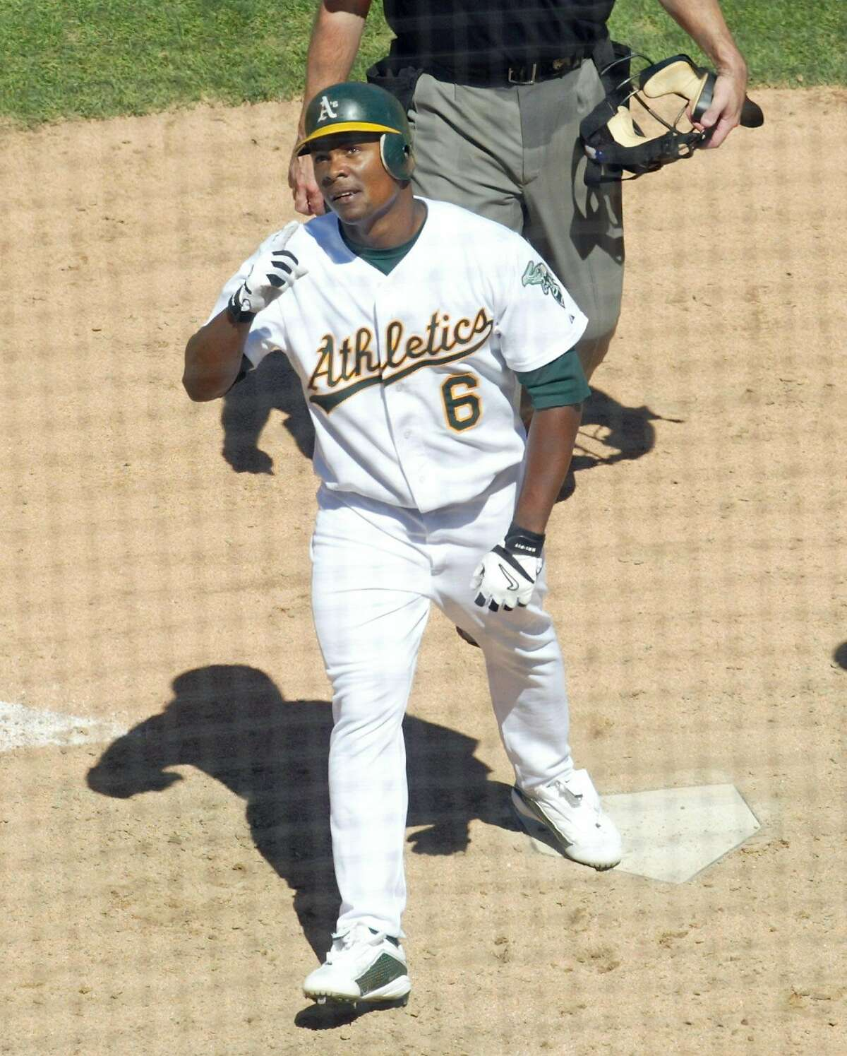 Oakland Athletics' Jose Guillen points to the sky after hitting his second solo home run of the day against the Toronto Blue Jays, in the seventh inning Saturday, Aug. 16, 2003, in Oakland, Calif. The A's won 6-4. (AP Photo/D. Ross Cameron)