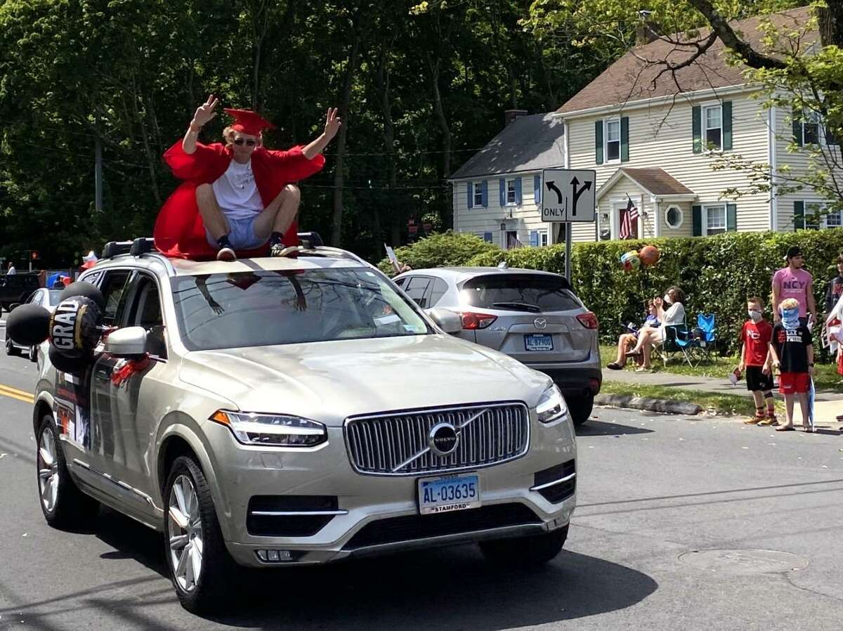 New Canaan High School Class of 2020 graduates parade through the town in vehicles with their families on Monday, June 15, 2020. The parade was held for the graduates for their graduation to meet the Center for Disease Control and Prevention's, (CDC), guidelines of social distancing during the coronavirus pandemic, and Gov. Ned Lamont's orders allowing school districts in Connecticut to hold outdoor graduation ceremonies with a limit of up to 150 people.The town's high school class of seniors was 301, and there were also school, and district staff, and families, who would be attending, which exceeded the amount the state allowed, thus prompting the parade to be held, regarding the congregating, as has previously been discussed. The district's administration is still planning to have a simple graduation celebration with speeches, and perhaps music, July 31, 2020. The administration is going to develop plans in accordance with any new guidelines released by the Centers for Disease Control and Prevention, (CDC), before then, according to New Canaan Board of Education Chairman Katrina Parkhill.