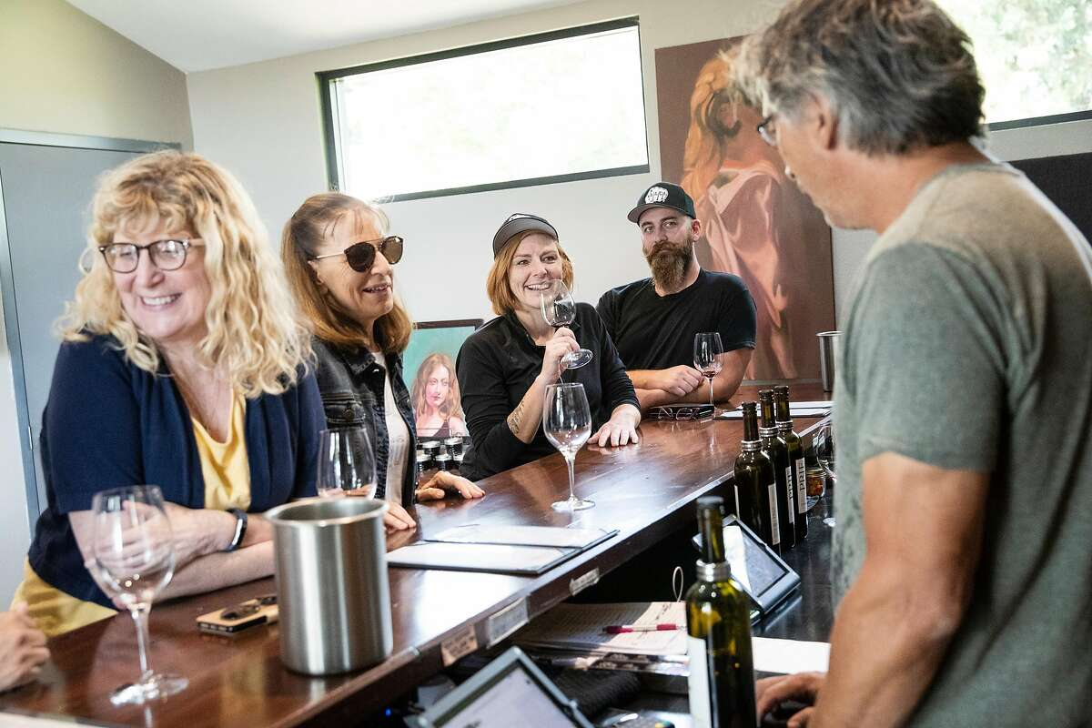 Winemaker John Gash (right) talks with customers in the tasting room at PRIE Winery in Lodi, Calif., on Saturday, September 28, 2019.