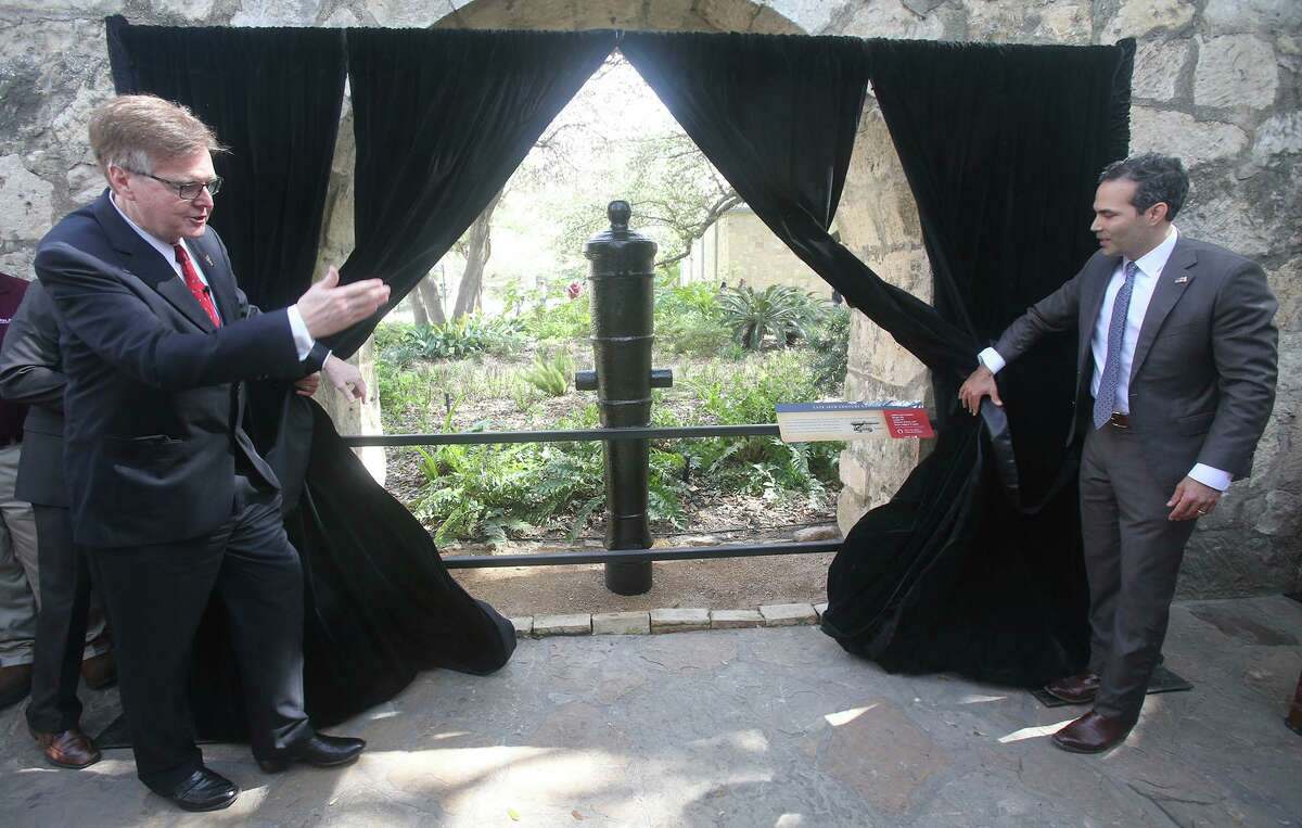 Texas Lt. Govenor Dan Patrick (left) and Texas Land Commissioner George P. Bush (right) unveil a late 18th Century cannon that was recently placed at the Alamo after being restored by Texas A&M University. This cannon is one of two that were restored and unveiled as a part of the celebration held to honor Texas Independence Day.