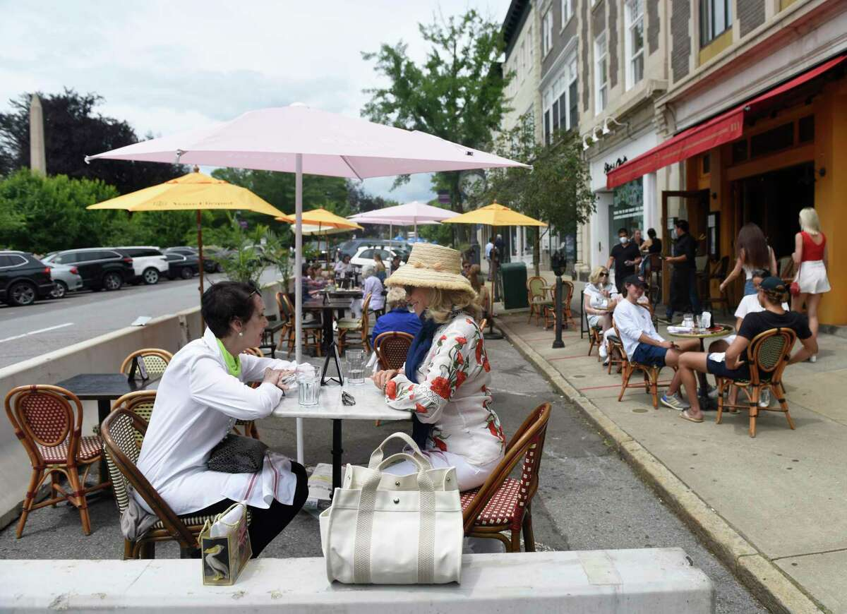 Diners enjoy lunch outdoors in one of the