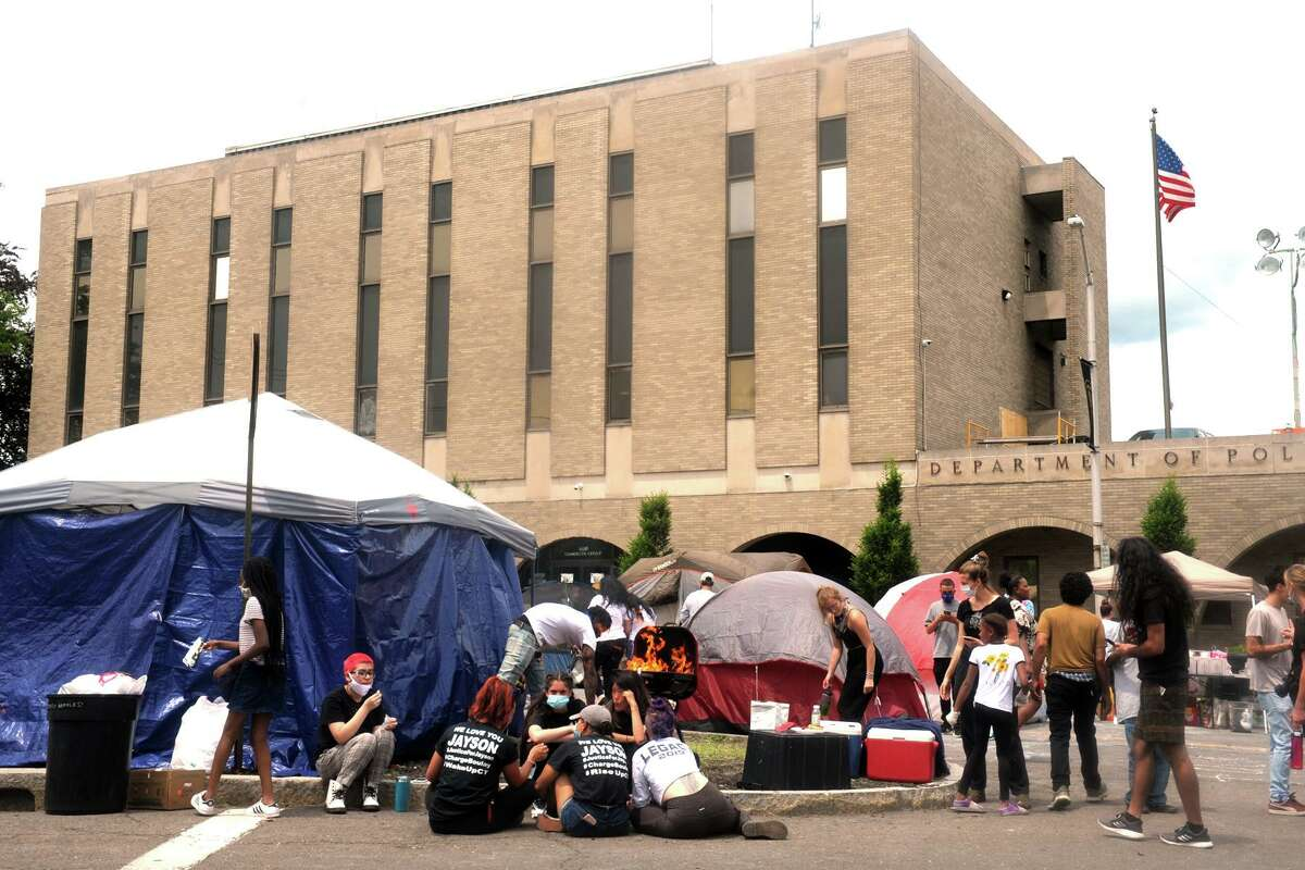 A group of protesters remained camped out in front of Police Headquarters, in Bridgeport, Conn. June 15, 2020.