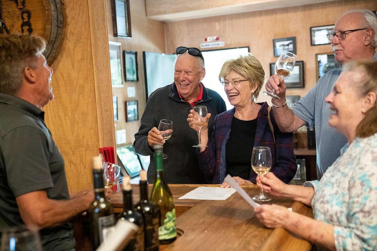 Winemaker Greg Burns (left) leads visitors to Jessie's Grove Winery in a tasting in the tasting room in Lodi, Calif., on Sunday, September 29, 2019.