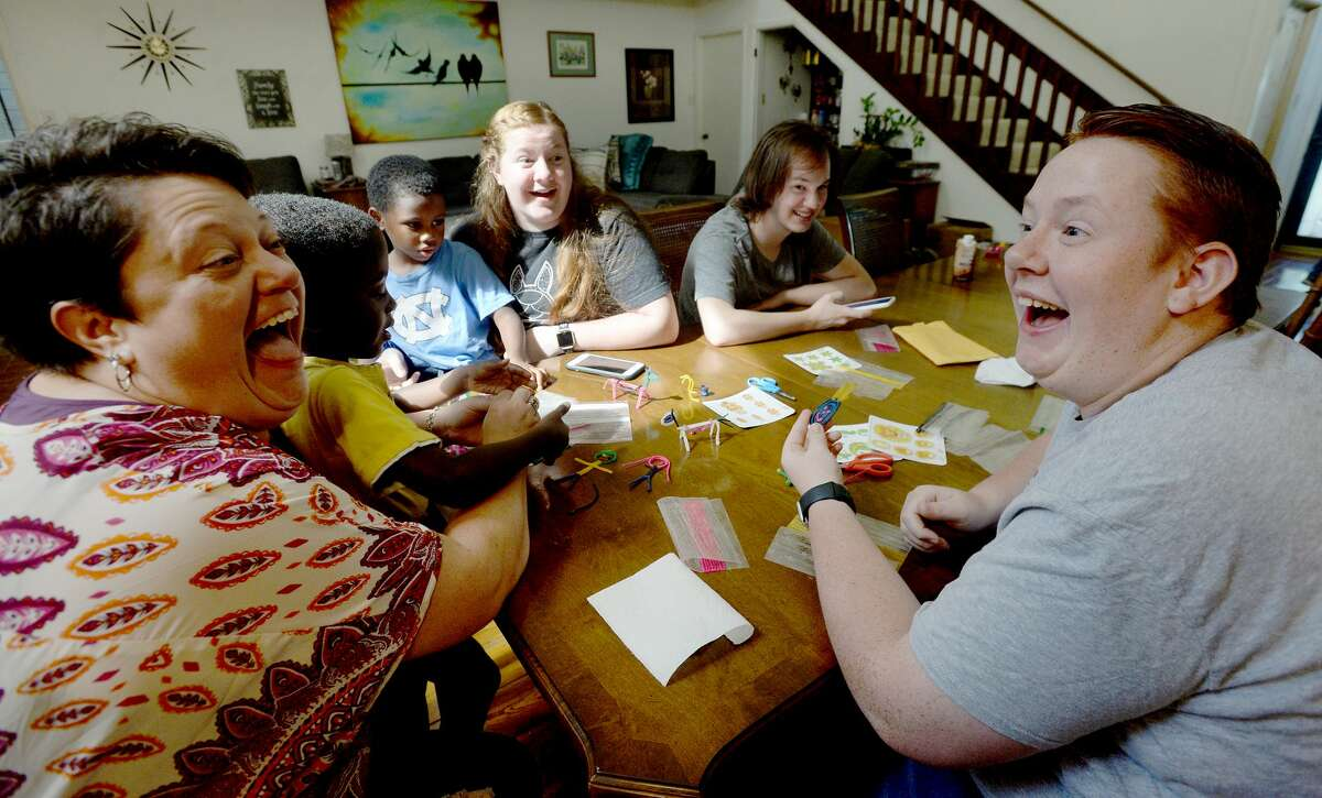 Rachel and son Micah Medlin joke with one another as they gather round the table for morning crafts with the younger children at their home in Beaumont. Photo taken Thursday, June 4, 2020 Kim Brent/The Enterprise