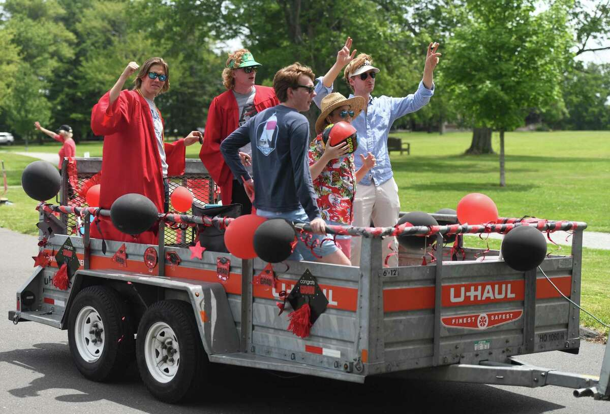 Photos from the New Canaan High School Class of 2020 drive-thru graduation parade at Waveny Park in New Canaan, Conn. Monday, June 15, 2020. The 301 graduates of New Canaan's Class of 2020 took a raucous ride through town with their families as teachers waited to congratulate them for their achievements as they passed through Waveny Park.