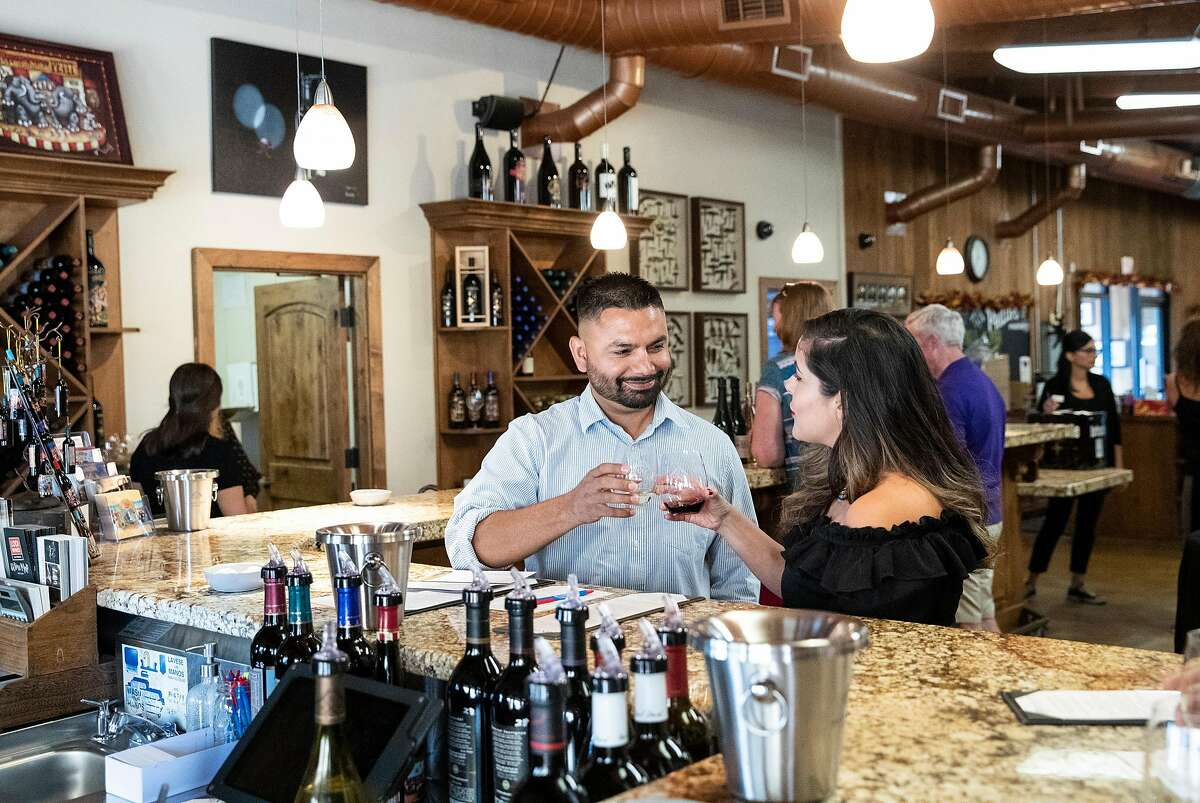 Jaime Rodriguez (left) and Anais Rodriguez wine taste in one of the two tasting rooms at Michael David Winery in Lodi, Calif., on Saturday, September 28, 2019. In addition to wine tasting the property features a cafe, outdoor seating and activities such as bocce ball.
