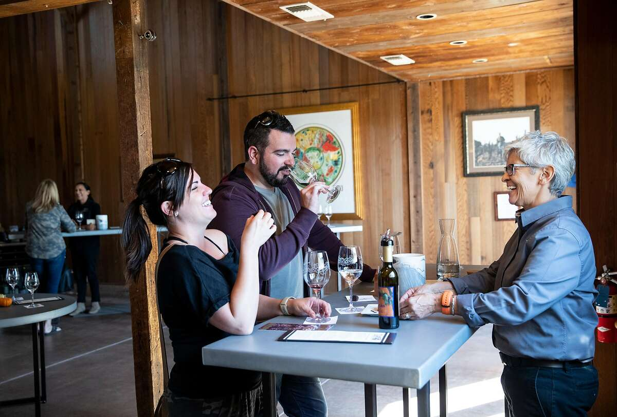 Jessica Ktistakis (left) and Anthony Ktistakis wine taste with the help of wine educator Bo Baca (right) at Lucas Winery while visiting wineries on their honeymoon in Lodi, Calif., on Thursday, October 10, 2019. The winery features hosted tasting experiences where each group of visitors has a one-on-one experience with a wine educator.