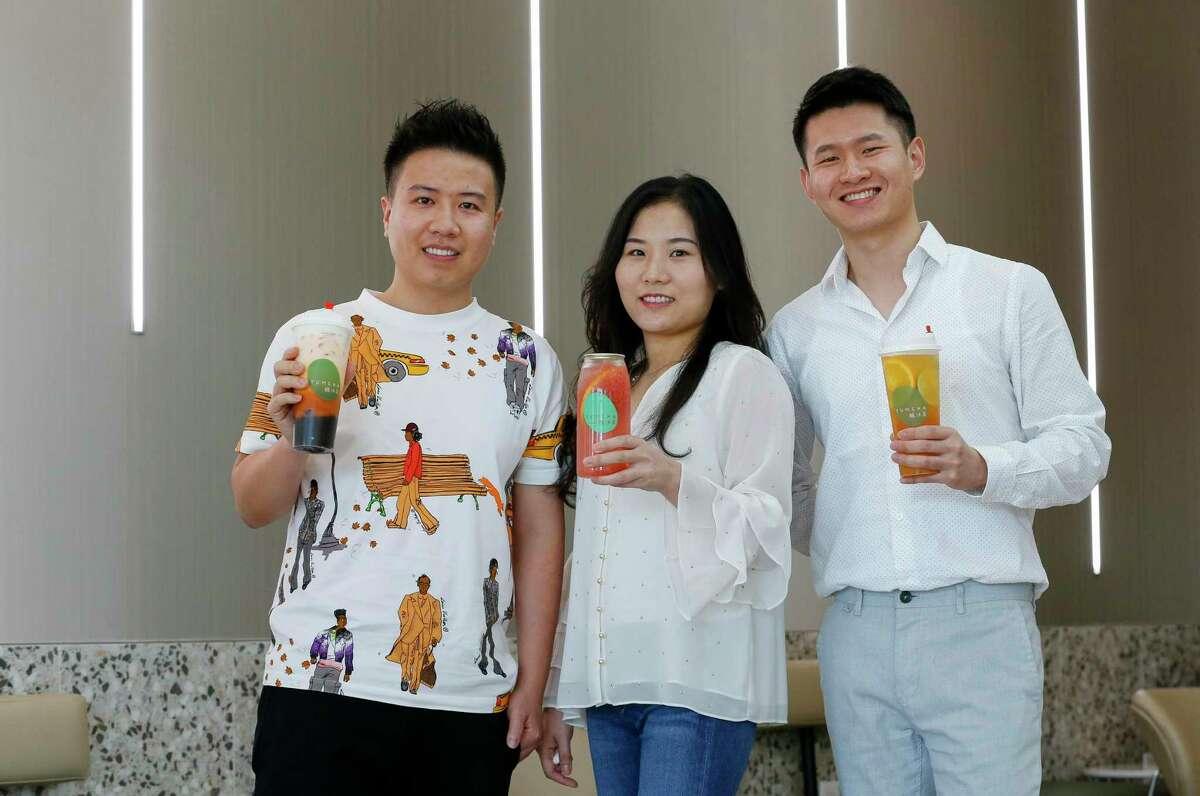 Yumcha Tea House and Bakery owners Jun Lin, from left, Xiuqing Huang, and John Yang at their shop at Dun Huang Plaza