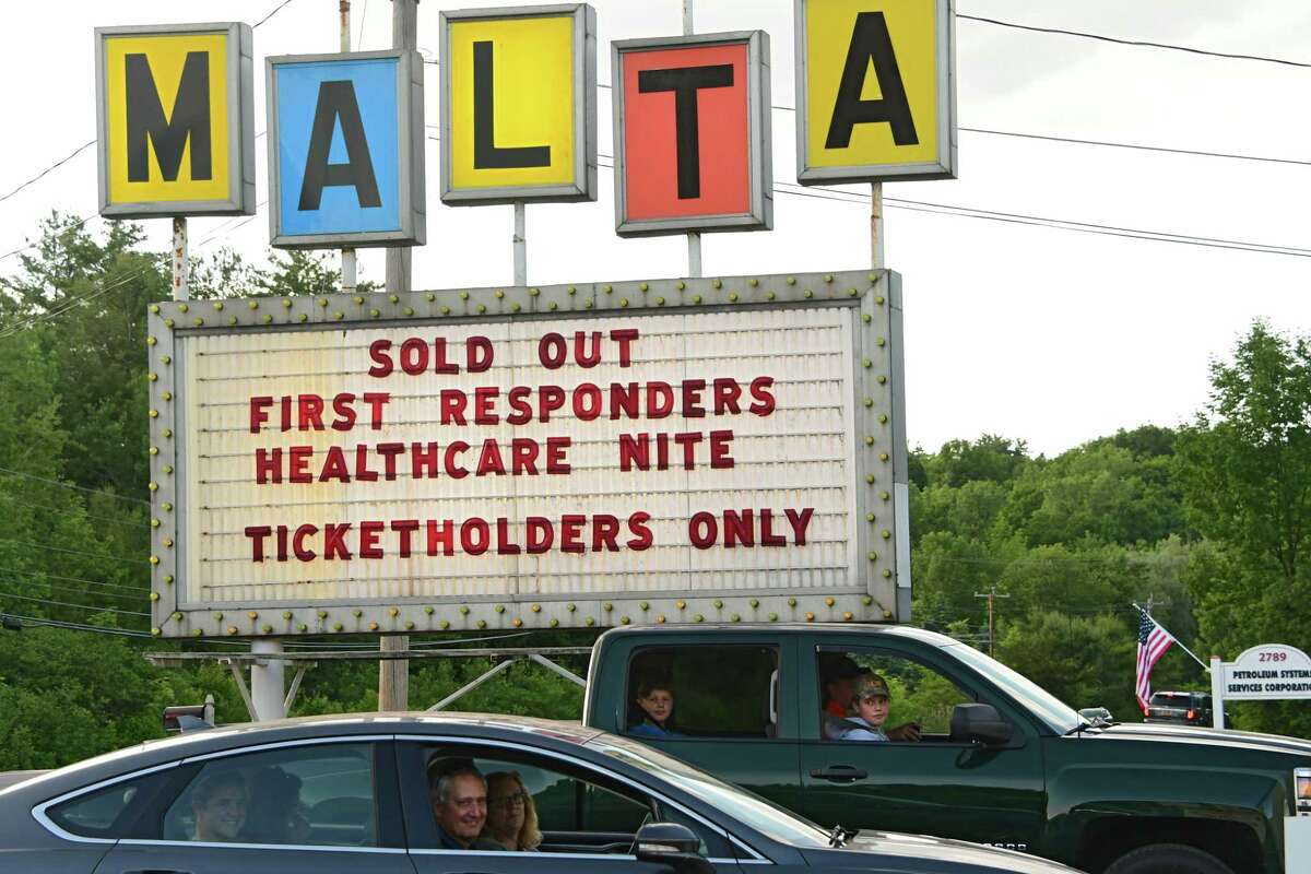 People arrive as Malta Drive-In holds Appreciation Night for COVID-19 first responders and healthcare providers on Monday, June 15, 2020 in Malta, N.Y. Jukebox Rebellion and Comedian Chris O?•Leary performed before the movie. There were fireworks and the feature movie was ?'National Lampoon?•s Vacation?