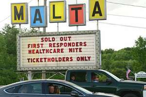 People arrive as Malta Drive-In holds Appreciation Night for COVID-19 first responders and healthcare providers on Monday, June 15, 2020 in Malta, N.Y. Jukebox Rebellion and Comedian Chris OÕLeary performed before the movie. There were fireworks and the feature movie was ÒNational LampoonÕs VacationÓ (Lori Van Buren/Times Union)