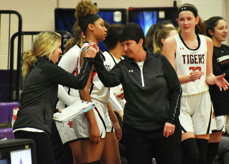 Edwardsville coach Lori Blade congratulates assistant coach Caty Ponce after the team's win over Collinsville in the Class 4A Collinsville Regional championship game in February. Ponce was named the program's head coach on Monday.