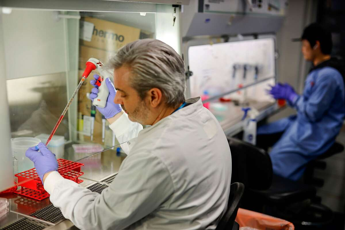 In this photo taken on February 10, 2020 Doctor Paul McKay, who is working on an vaccine for the 2019-nCoV strain of the novel coronavirus poses for a photograph using a pipette expresses coronavirus onto surface protein to apply cell cultures, in a research lab at Imperial College School of Medicine (ICSM) in London on February 10, 2020.