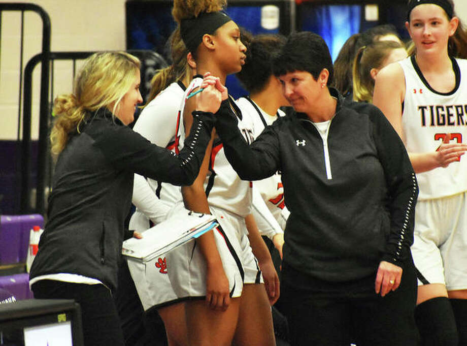 Edwardsville assistant Caty Ponce (left) congratulates coach Lori Blade after the Tigers' victory over Collinsville on Feb. 21 in the title game of the Collinsville Class 4A Regional girls basketball tournament in Fletcher Gym. On Monday, Ponce was approved to replace the retiring Blade as the Tigers head coach. Photo: Matt Kamp / Hearst Illinois