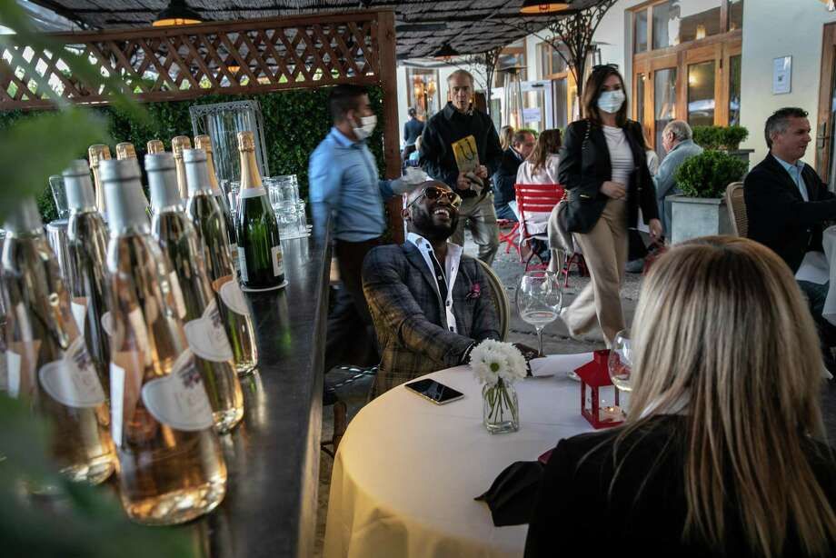 Withley Verdiner, a wardrobe stylist at Saks Fifth Avenue, enjoys drinks at L'escale restaurant in Greenwich, Connecticut. Photo: John Moore / Getty Images / 2020 Getty Images