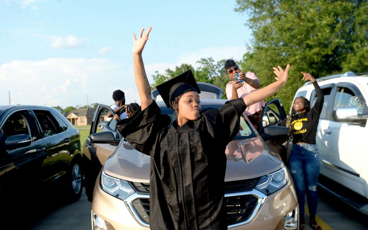 Latovia Miller celebrates after officially moving her tassle to the right as Evolution Academy graduates its 7th senior class at its Beaumont campus during an outdoor drive-up ceremony at the school Monday. Photo taken Monday, June 15, 2020 Kim Brent/The Enterprise