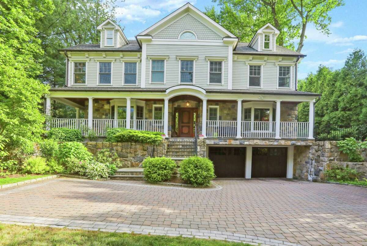 4 Buxton Lane is listed for $3.35 million by Berkshire Hathaway HomeServices, New England Properties. The six-bedroom stone-and-clapboard New England colonial has 5,351 square feet of living space, with generously proportioned interiors. The floor plan is bright and open, the seller pointed out.