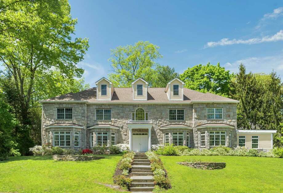 14 Coventry Lane debuted in 2006 on a 0.44-acre lot on a Riverside cul-de-sac. The six-bedroom stone colonial was more recently updated in 2018. Berkshire Hathaway HomeServices, New England Properties, is the listing brokerage for the $3.29 million property. Photo: Contributed Photo
