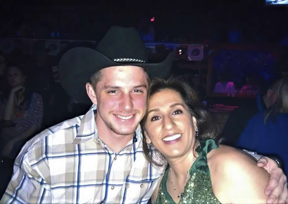 This image provided by Joey Reed, shows Trevor Reed and his mom Paula Reed in 2014 in Arlington, Texas. The parents of Reed, a former U.S. Marine who has been jailed for nearly a year in Moscow on charges that he assaulted police officers, are urging the court system and government to ensure a fair trial for their son. The parents of Trevor Reed spoke Monday to The Associated Press as a Russian court sentenced another American man to more than a decade in prison in an unrelated espionage case. (Joey Reed via AP) Photo: Joey Reed/AP / Joey Reed