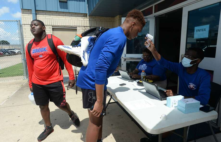 Athletes have their temperatures taken as they check in on the first day of summer conditioning at West Brook Monday morning. While most schools started the summer workouts when the state permitted last week, BISD programs waited until this week to hold camps. Photo taken Monday, June 15, 2020 Kim Brent/The Enterprise Photo: Kim Brent/The Enterprise