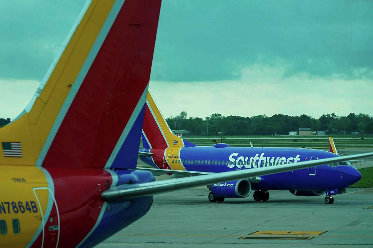 A Southwest Airlines plane taxis to the gate at Hobby Airport in Houston on Friday, March 20, 2020.