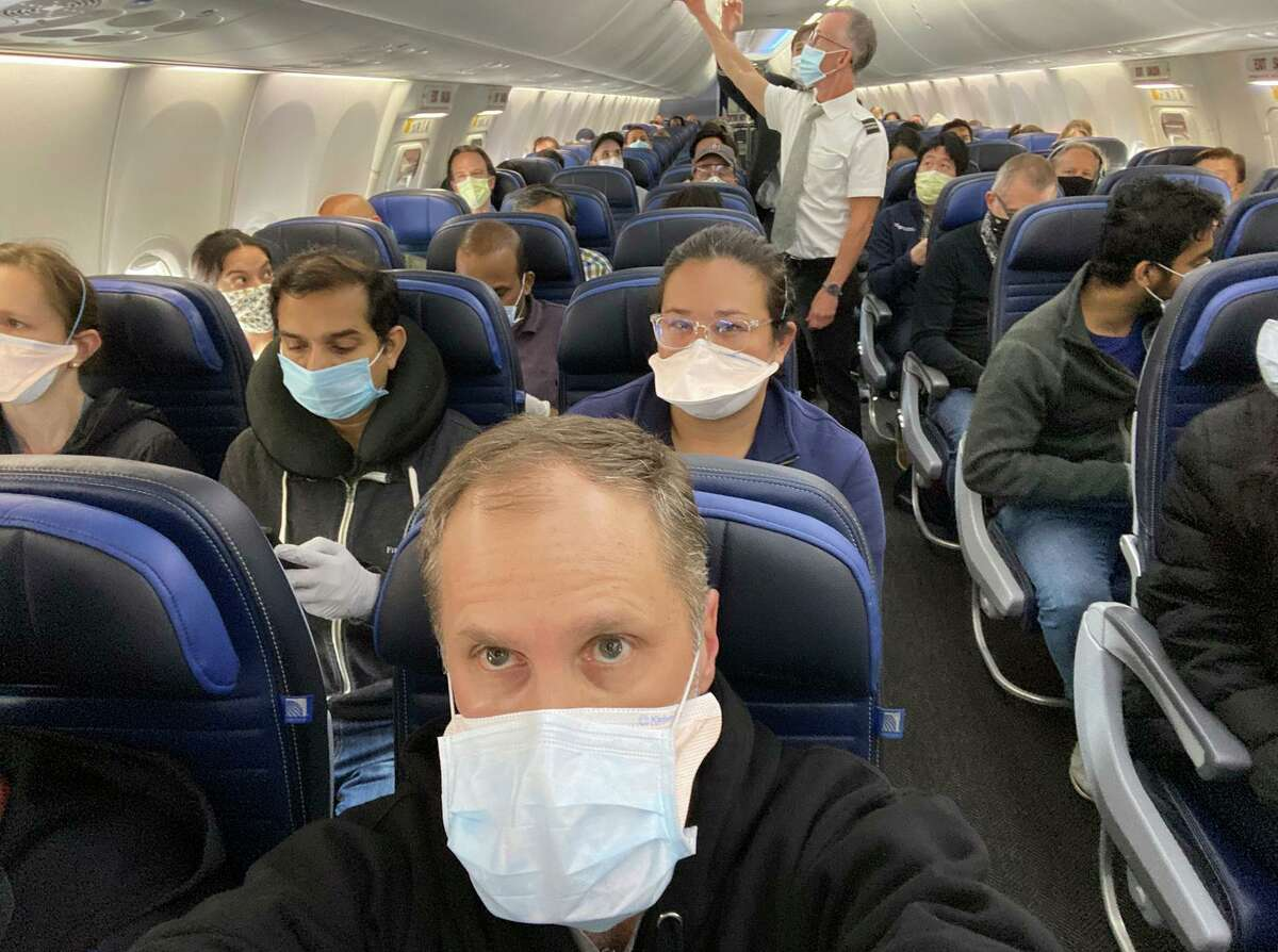 UCSF cardiologist Ethan Weiss took a selfie to show a nearly full United Airlines flight to San Francisco.