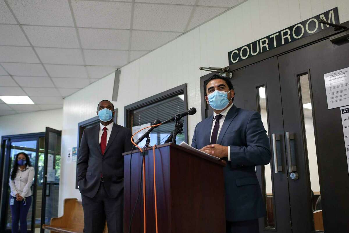 State Rep. Armando Walle, right, the Harris County recovery czar, speaks during a press conference as Judge Jeremy Brown, to his left, Harris County Justice of the Peace Precinct 7, Place 1, listens Thursday, June 11, 2020, in Houston.