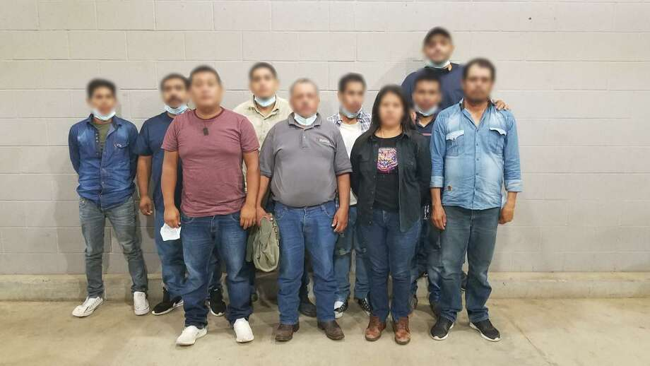 U.S. Border Patrol agents said three people tried to circumvent a federal checkpoint to smuggle these 10 immigrants who had crossed the border illegally. Photo: Courtesy Photo /U.S. Border Patrol