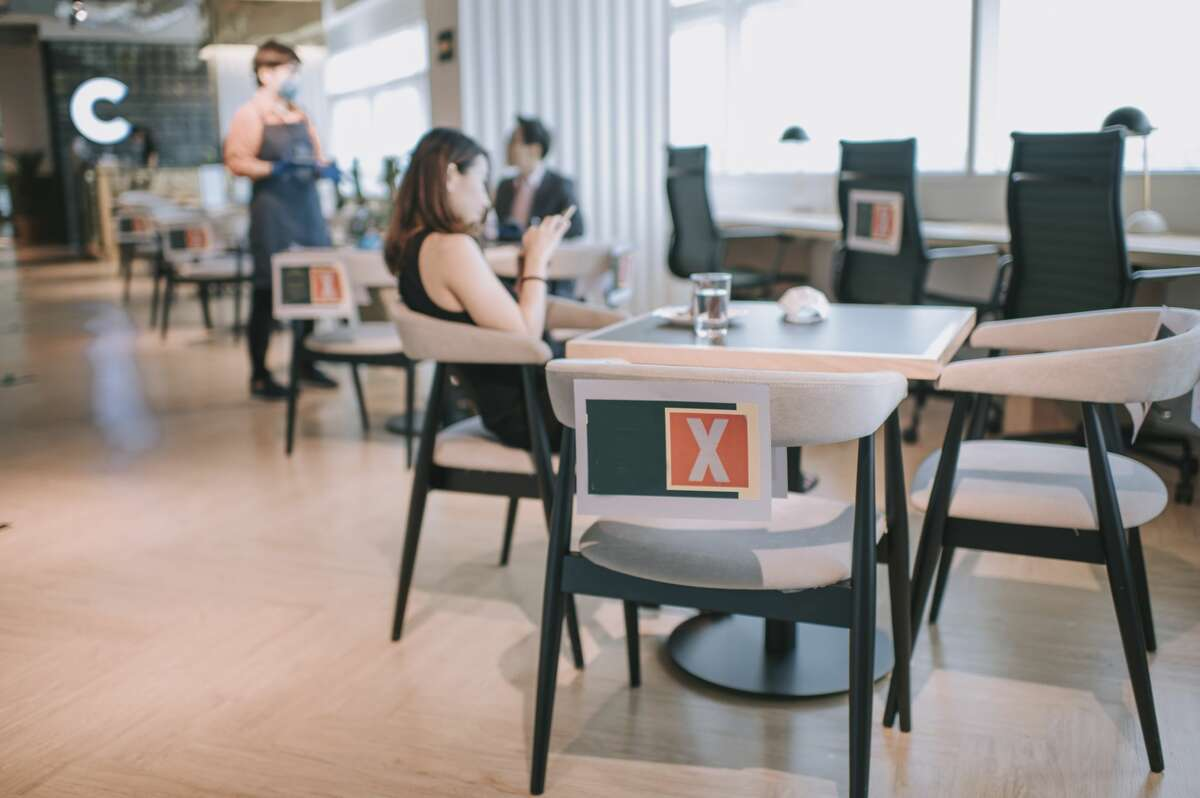 All indoor and outdoor tables with seating for customers must be separated by a minimum of 6 ft. in all directions. Wherever distancing is not feasible between tables, restaurants must place some kind of a barrier between tables. Those barriers must be at least 5 ft. in height and not block emergency and/or fire exits.