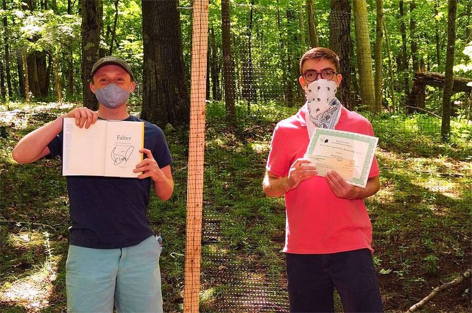 Wilton High School seniors Eli Grass, left, and Brett Gilman, right, received awards from the Wilton Land Conservation Trust. Photo: Contributed Photo