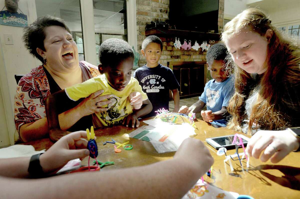 Rachel Medlin laughs as she and children, including Carter, Jacob, Tobias and Emily, have craft time at their home in Beaumont Thursday, June 4. Photo taken Thursday, June 4, 2020 Kim Brent/The Enterprise