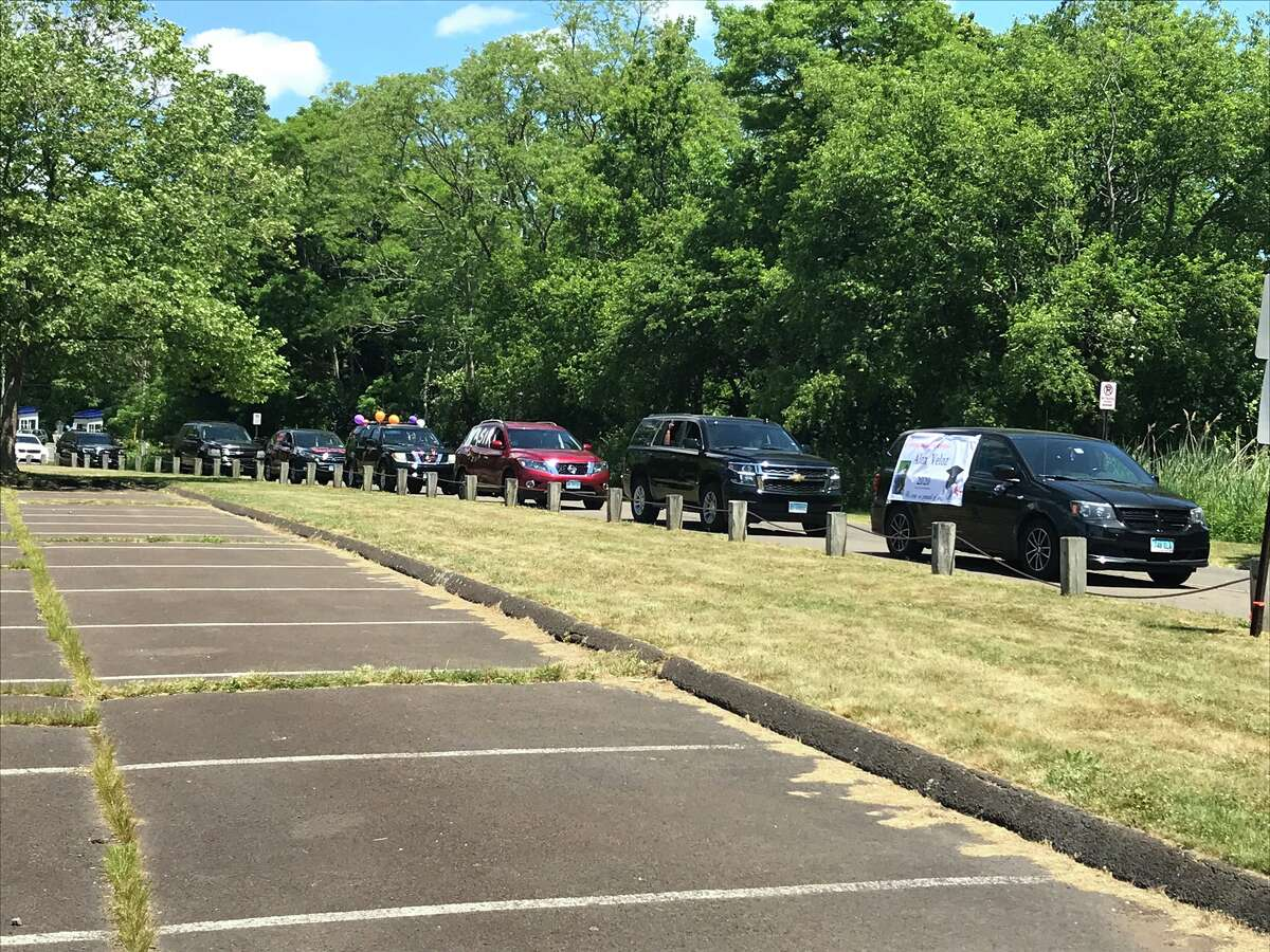 Cars at Lighthouse Point Park for high school graduation ceremonies.