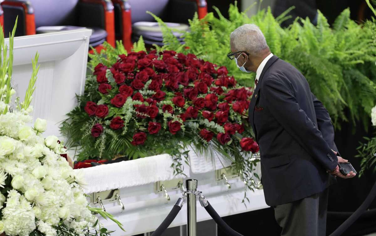 A man pays his respect during Texas Southern University's public visitation and memorial service for Dr. Thomas F. Freeman in TSU's Health & Physical Education Arena Tuesday, June 16, 2020, in Houston.