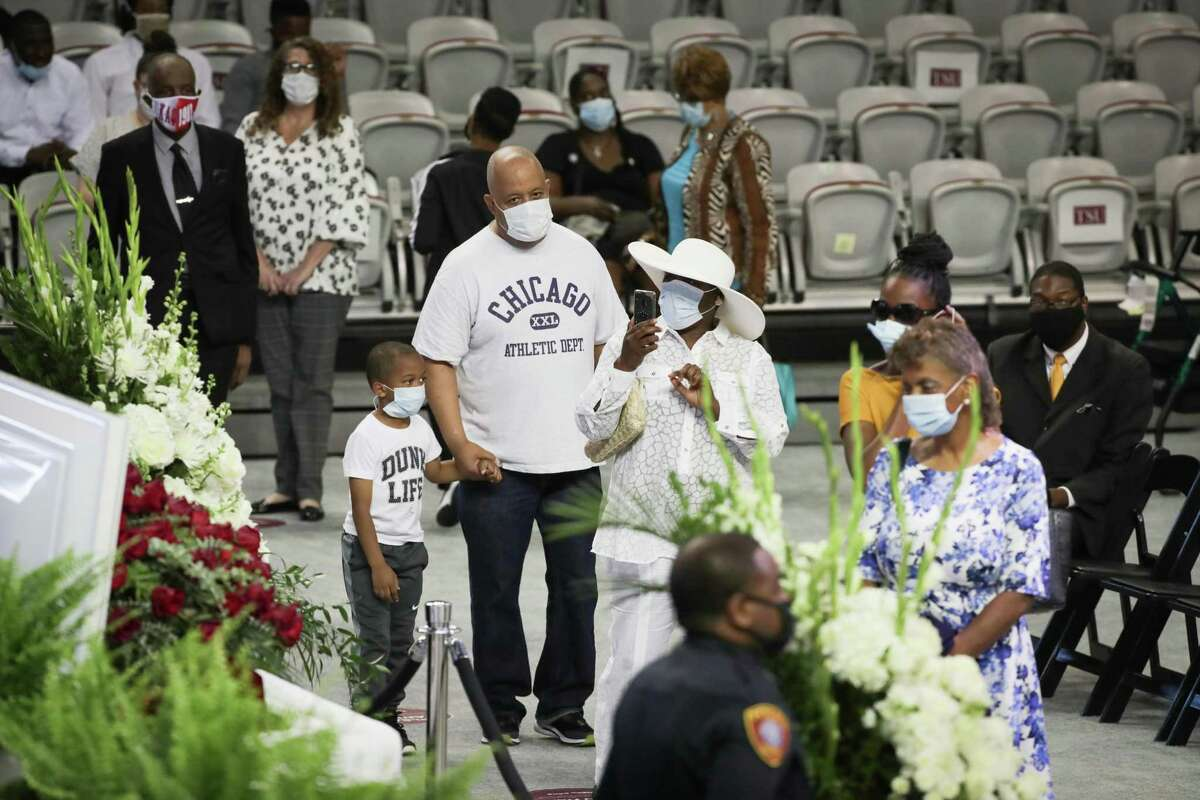 People pay their respects during Texas Southern University's public visitation and memorial service for Dr. Thomas F. Freeman in TSU's Health & Physical Education Arena Tuesday, June 16, 2020, in Houston.